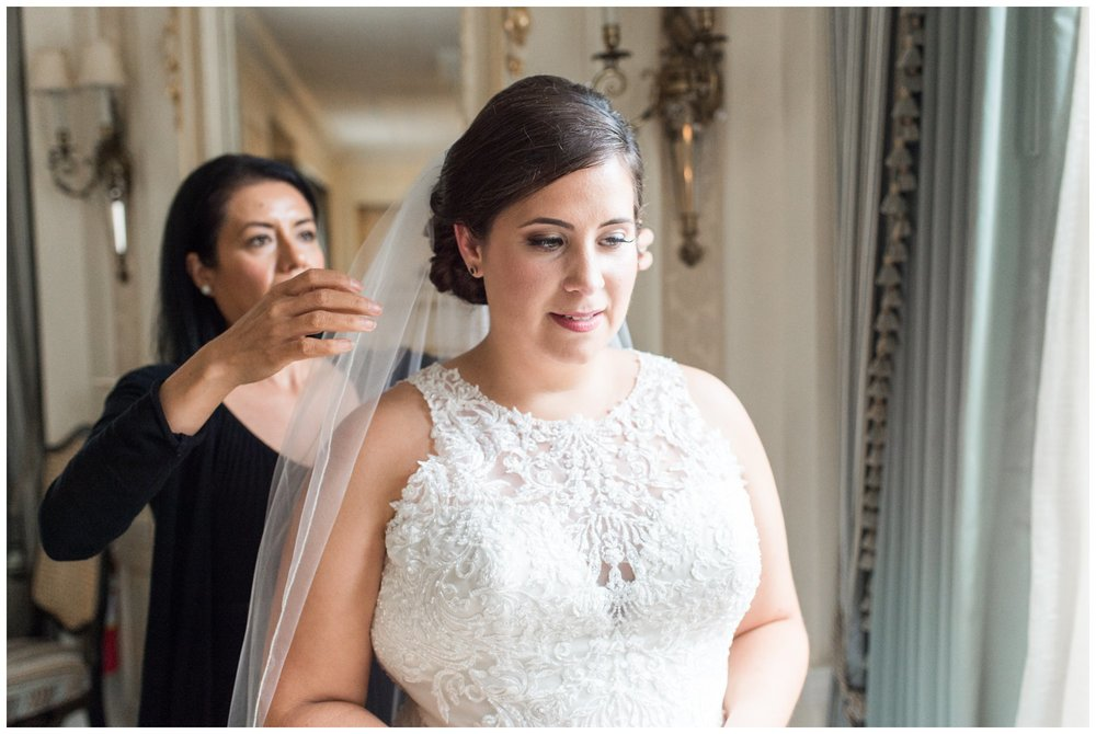 bride getting ready at Lenox Hotel Boston wedding with hair and veil done by Maricruz Hairstyles