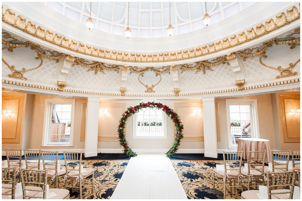 Lenox Hotel Boston Wedding ceremony in Dome Room with flower arch by Table and Tulip