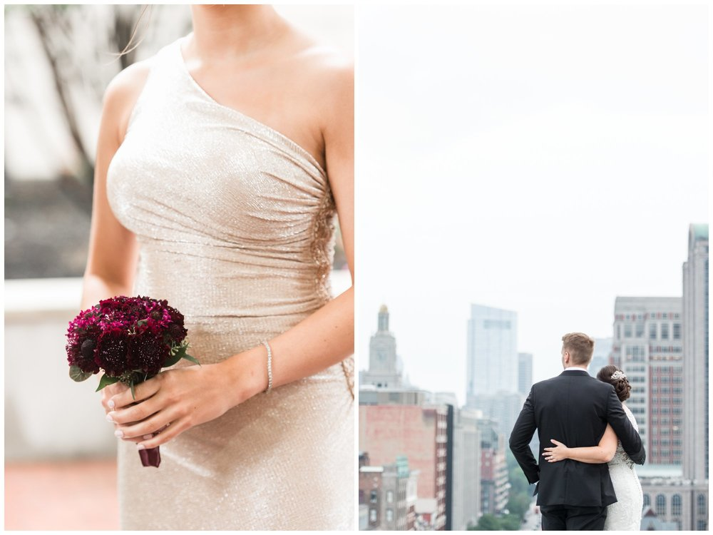 Lenox Hotel Boston Wedding bride and groom newlyweds portraits on hotel rooftop views of Boston skyline and bouquet by table and tulip