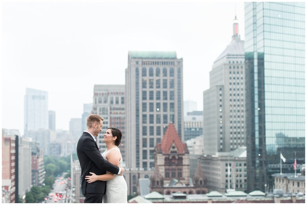Lenox Hotel Boston Wedding bride and groom newlyweds portraits on hotel rooftop views of Boston skyline