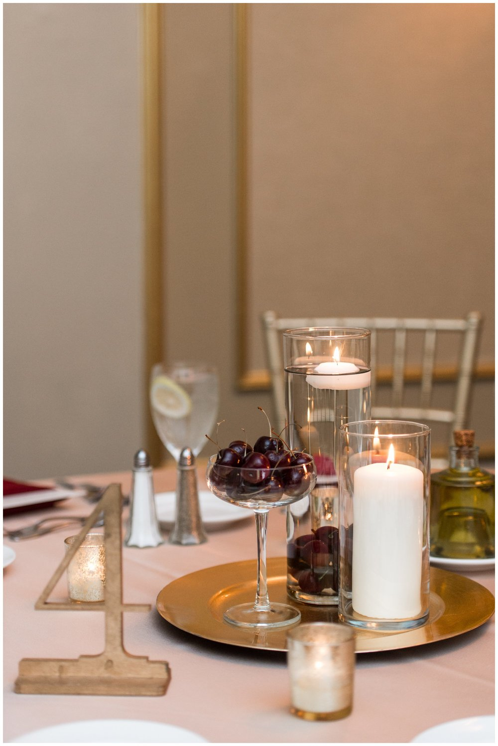Lenox Hotel Boston Wedding reception centerpieces with gold, cream, and burgundy, candles and cherries