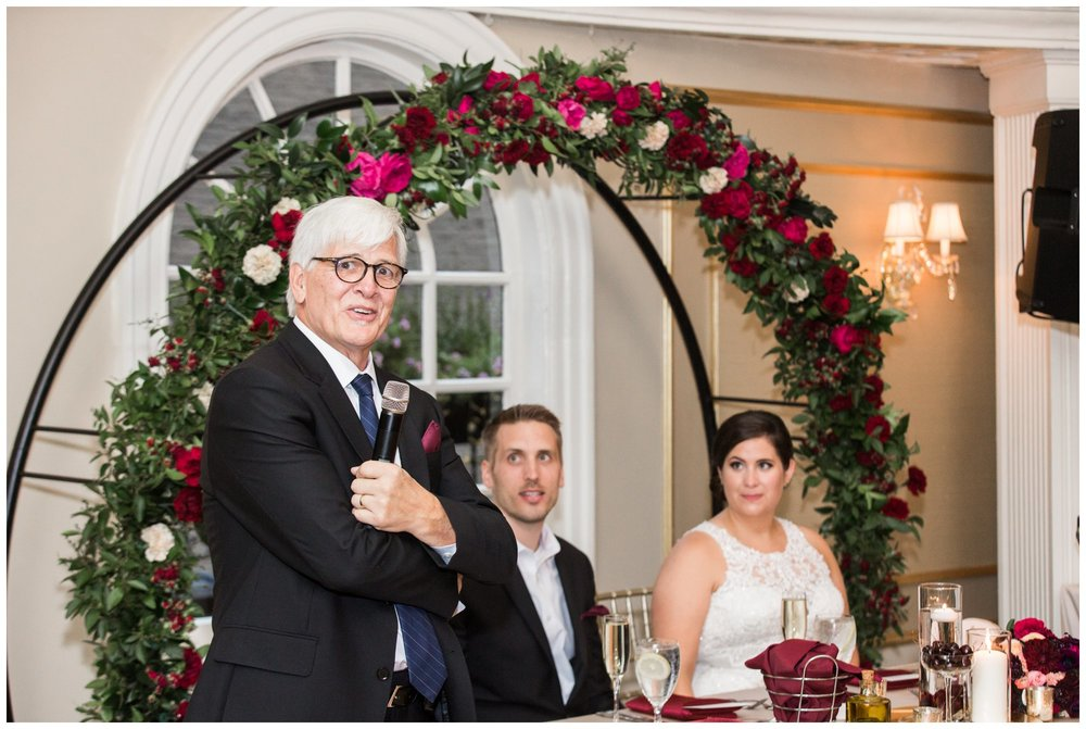 Lenox Hotel Dome Room Wedding reception Boston and floral arch by table and tulip
