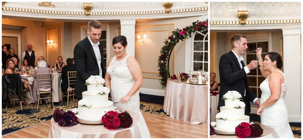 Lenox Hotel Dome Room Dessert Works wedding cake cutting by bride and groom