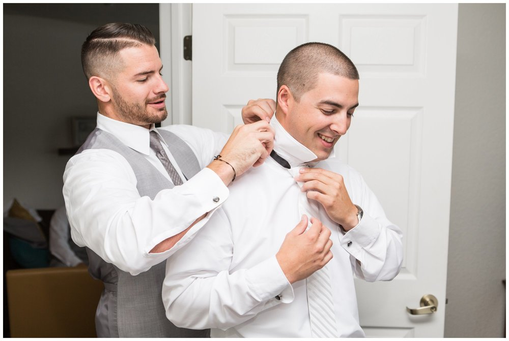 groom getting ready for summer wedding at the villa at riddler country club