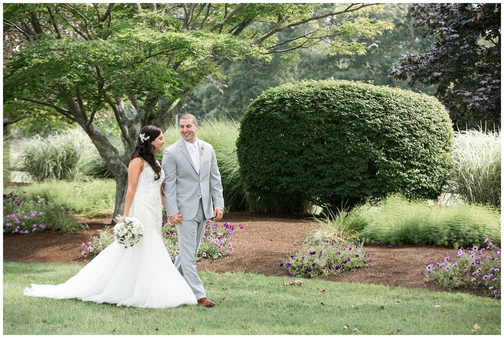 couples portraits for summer wedding at the villa at riddler country club