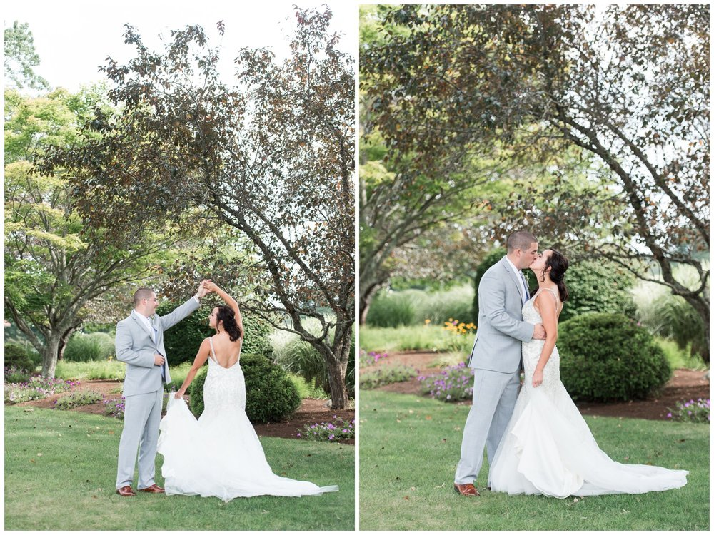 couples portraits for summer wedding at the villa at riddler country club mori lee gown  gray suit and lavender floral accents