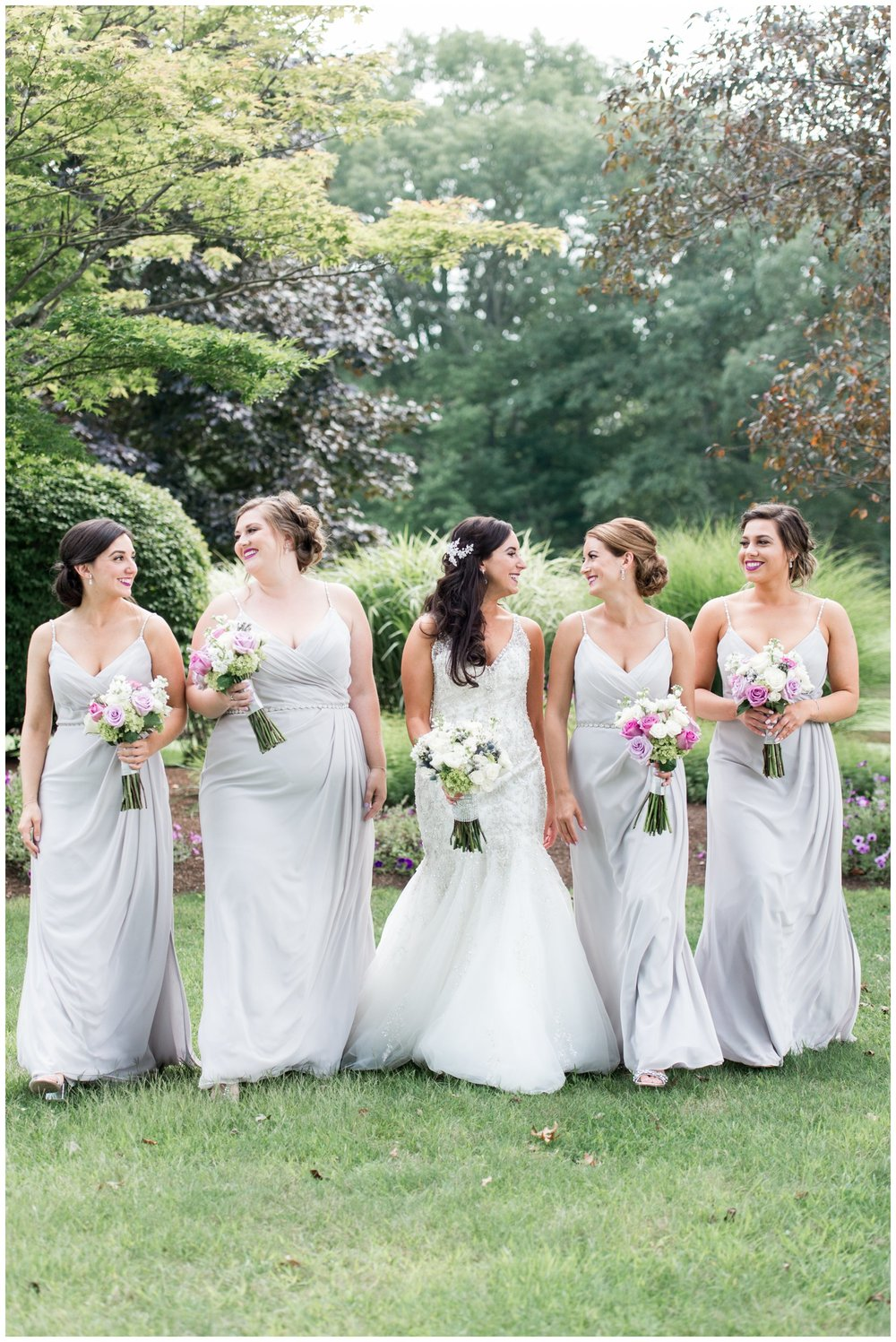 lavender bridesmaid dresses and mori lee wedding gown at summer wedding at the villa at riddler country club