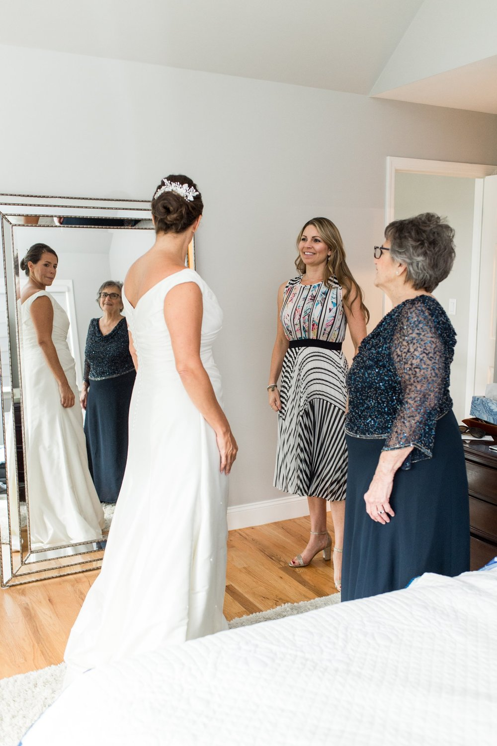 Bride wearing Augusta Jones wedding dress gets ready for nautical inspired wedding at Belle Haven Club in Greenwich CT