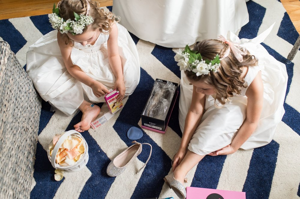 flower girls in flower crowns and white jcrew dresses get their sparkly shoes on for fall wedding at belle haven club