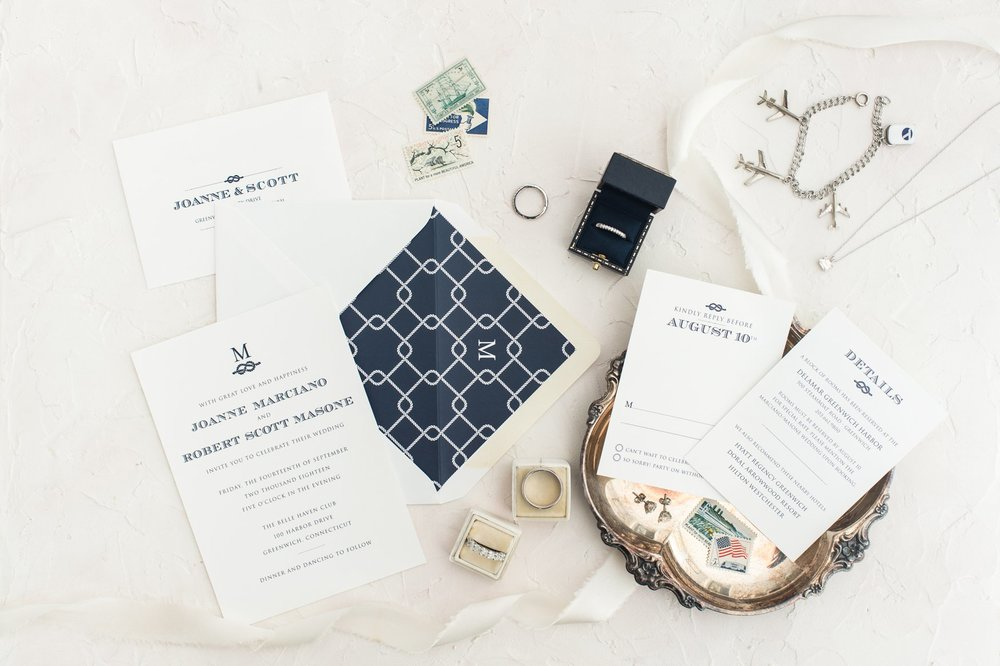 Styled flat lay of Social Alchemy navy and white nautical invitation suite for for fall wedding at belle haven club in greenwich ct