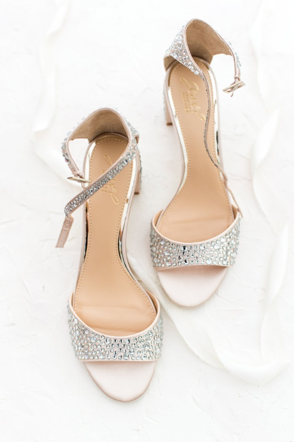 Jewel by Badgley Mischka sparkly chunky heel bridal shoes styled flat lay