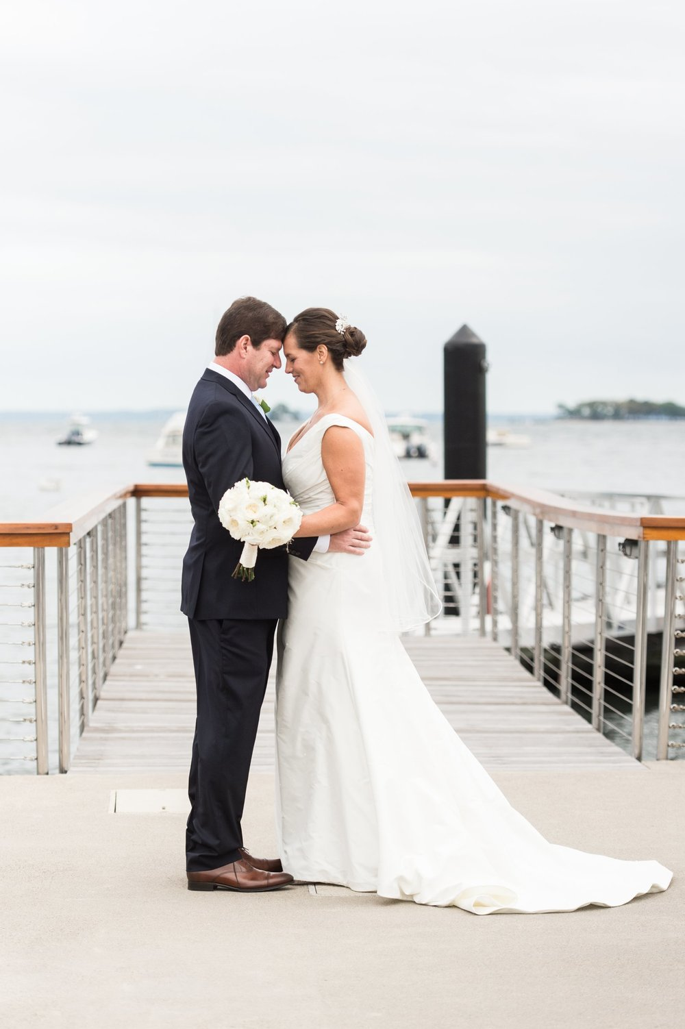 Bride and Groom First Look on the docks for an elegant nautical inspired navy and white Fall Wedding at Belle Haven Club in Greenwich CT