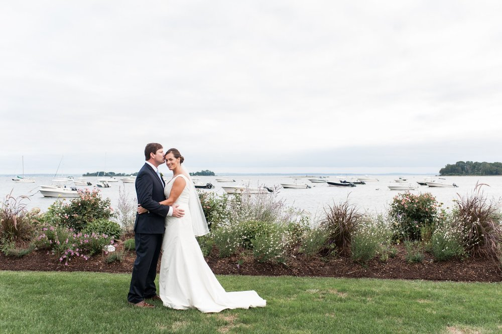 Bride and groom portraits as newlyweds on lawn at Belle Haven Club wedding in the fall in greenwich ct