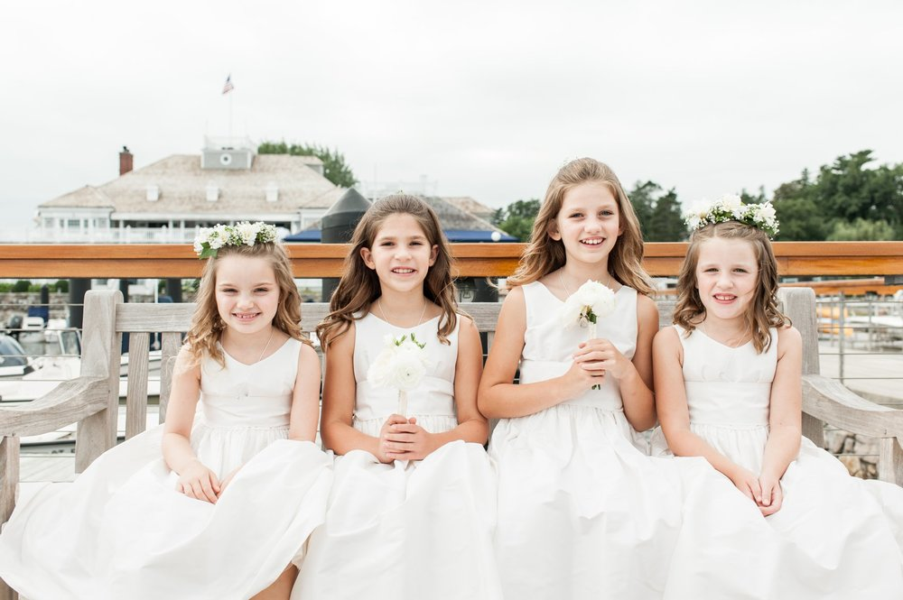 flower girls in jcrew dresses carrying flowers from green of greenwich at fall wedding at belle haven club