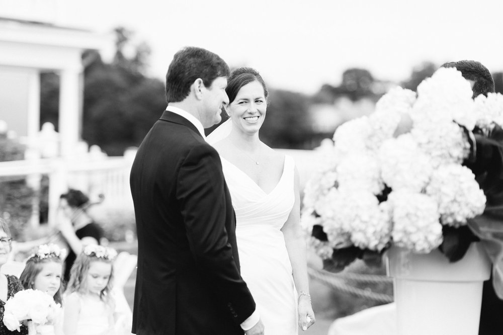 bride and groom during wedding ceremony on the lawn at belle haven club