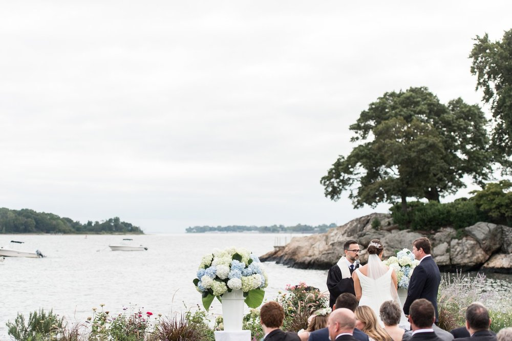 ceremony space overlooking the water with hydrangea at fall nautical inspired belle haven club wedding