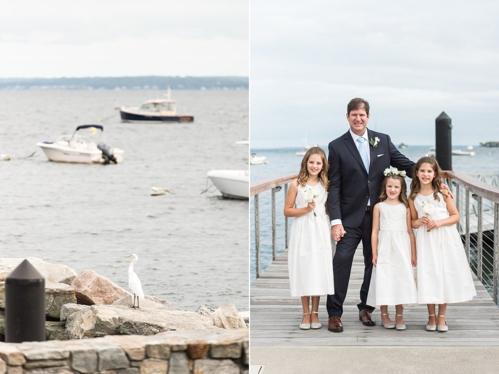 Groom and his three daughters as flower girls in jcrew dresses pose for portaits on docks at Belle Haven Club wedding