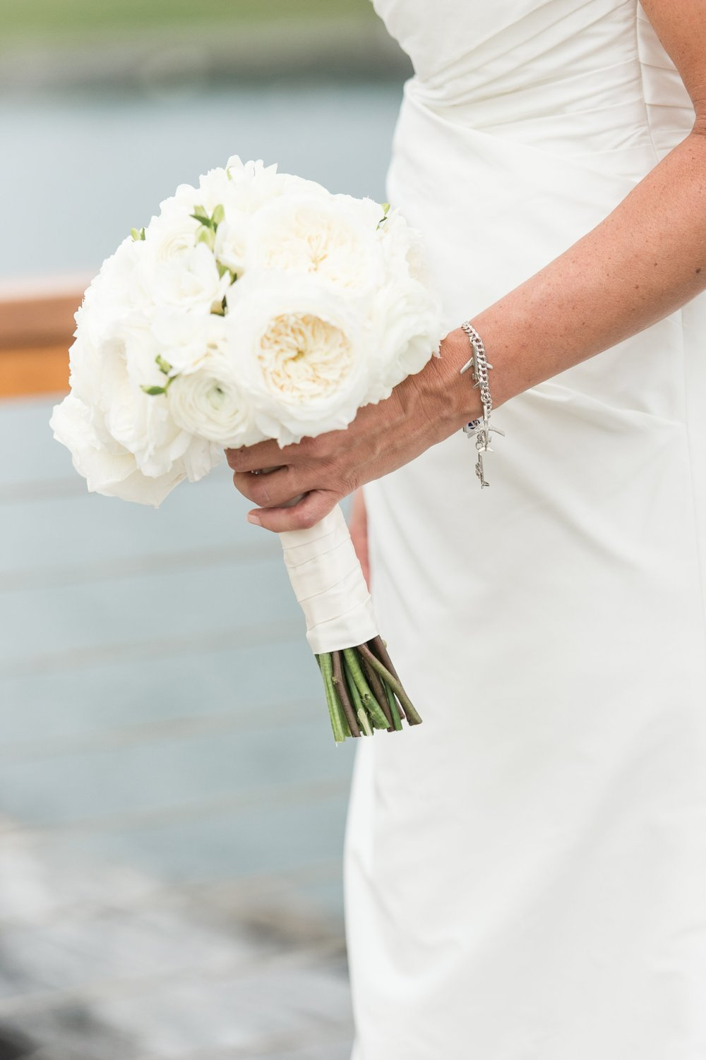 Fall Wedding at Belle Haven Club Bridal bouquet of white flowers from Green of Greenwich, CT