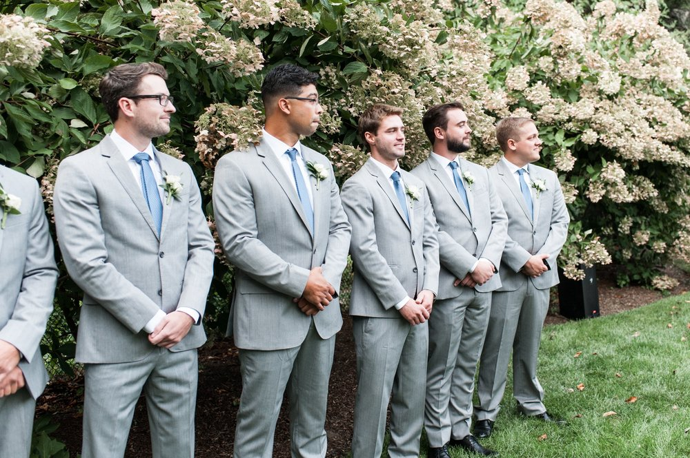 groomsmen in gray suits and dusty blue ties