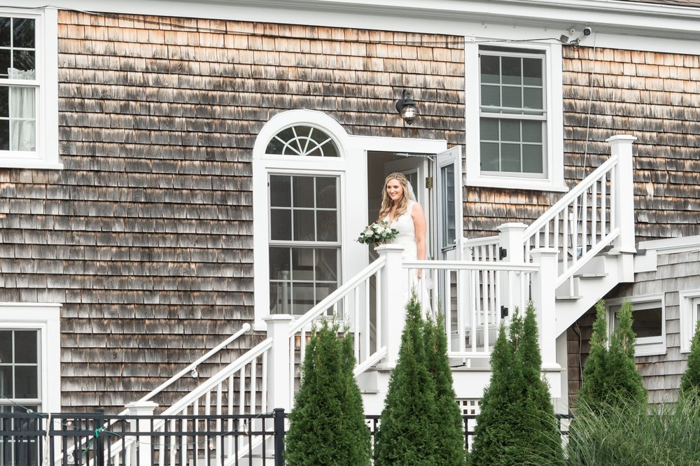 Bride makes entrance at back yard Cape Cod Wedding at ceremony at the Dennis Inn