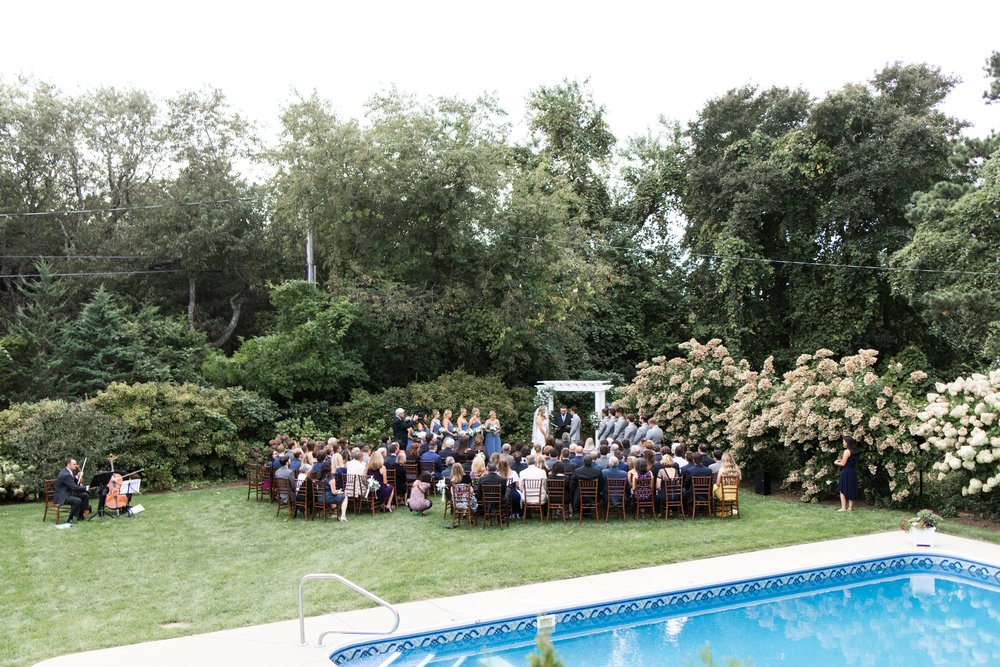 Backyard ceremony with pergola at the Dennis Inn