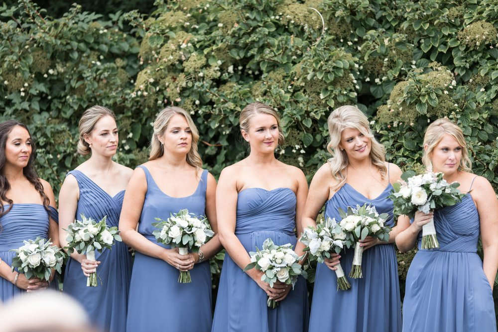bridesmaids in dusty blue with green and white bouquets by Designers Touch Florals at Dennis Inn Cape Cod Wedding