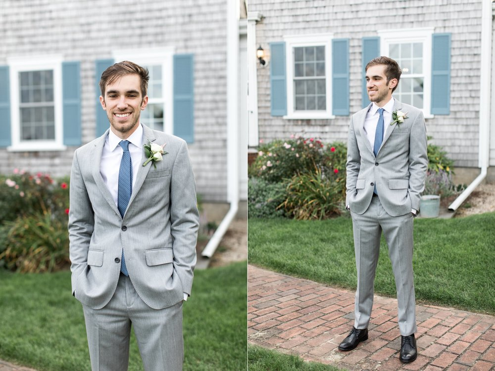 groom in gray suit with blue tie poses for portraits at the Dennis Inn at Cape Cod Wedding