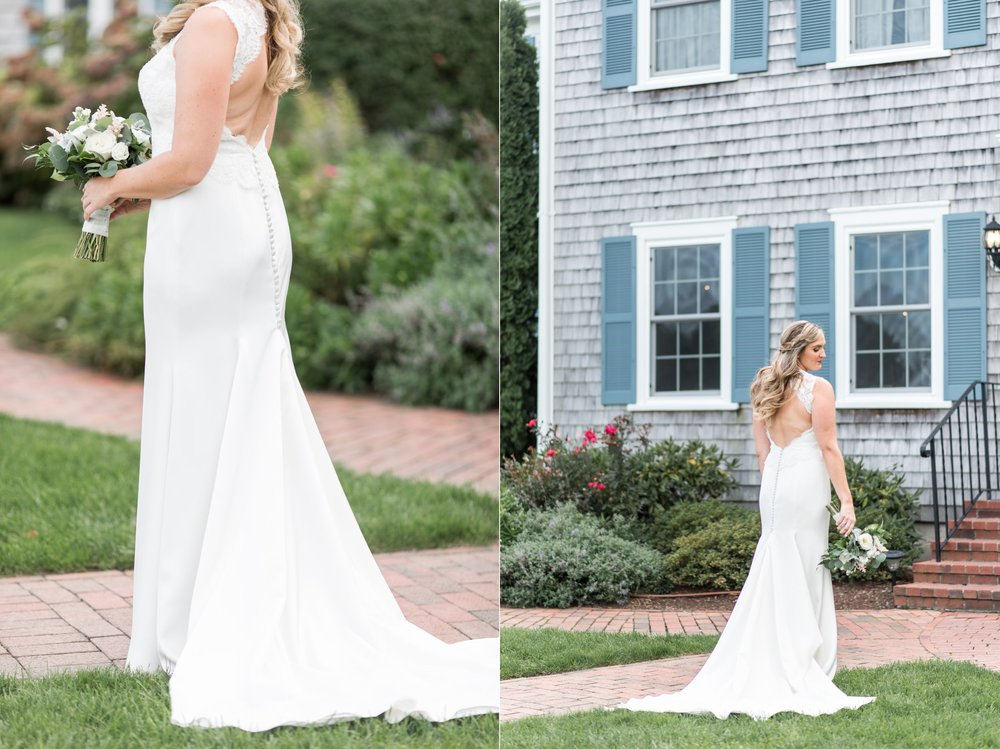 bridal style in lace sheath dress loose curls and braid in hair with cream and green bouquet at Cape Cod wedding