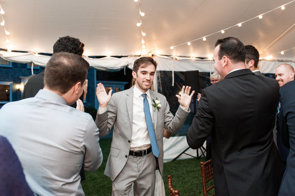 bride and groom enter their tented wedding reception at the dennis inn on cape cod
