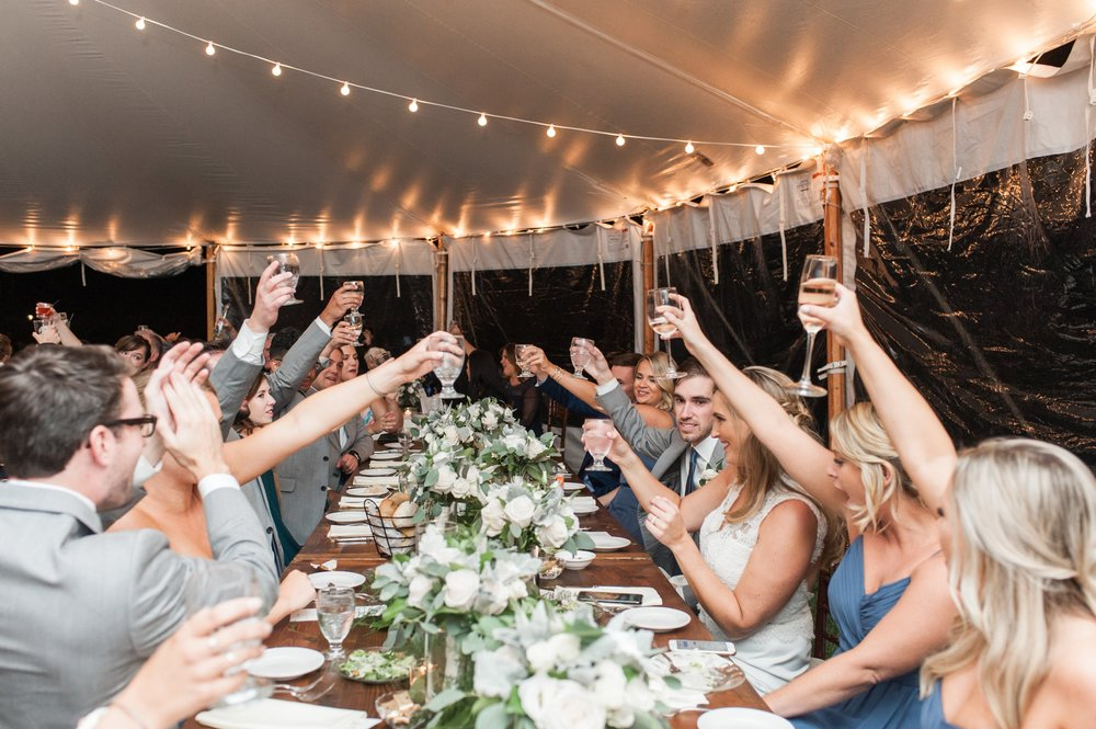 tented wedding reception toast at the head table at the Dennis Inn on Cape Cod