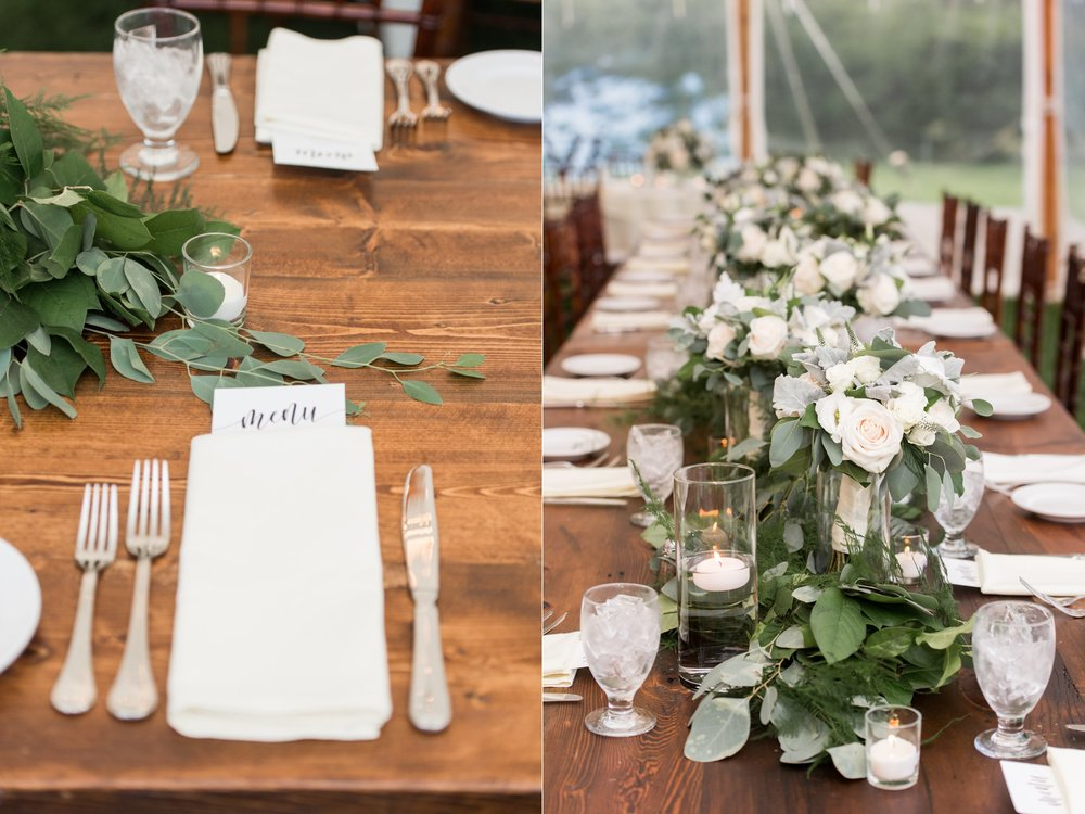 tented wedding reception decor bistro lights lush green table runners and white floral centerpieces with menu cards and candles