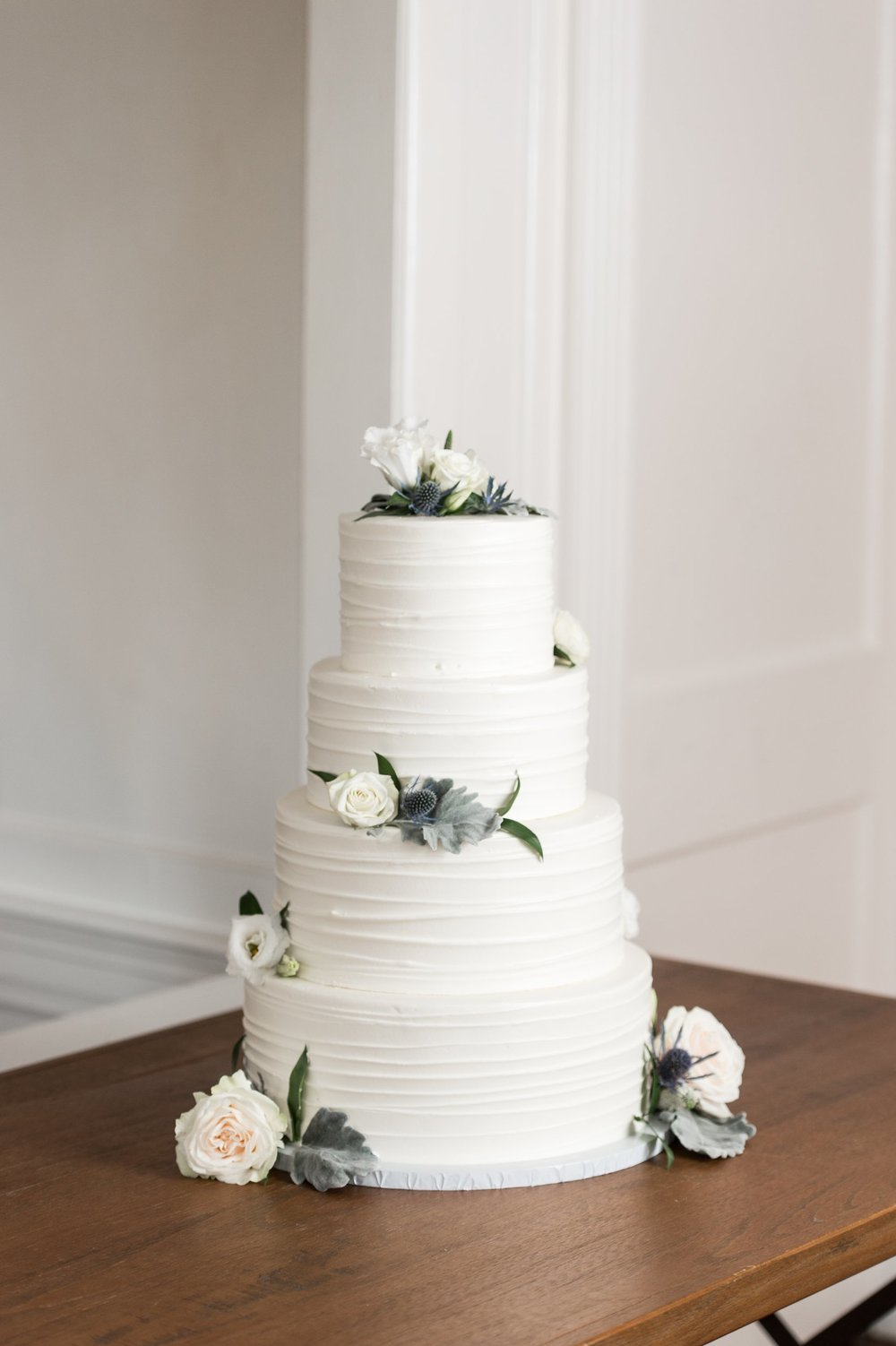 classic cape cod wedding cake with flowers by cottage street bakery at dennis inn wedding