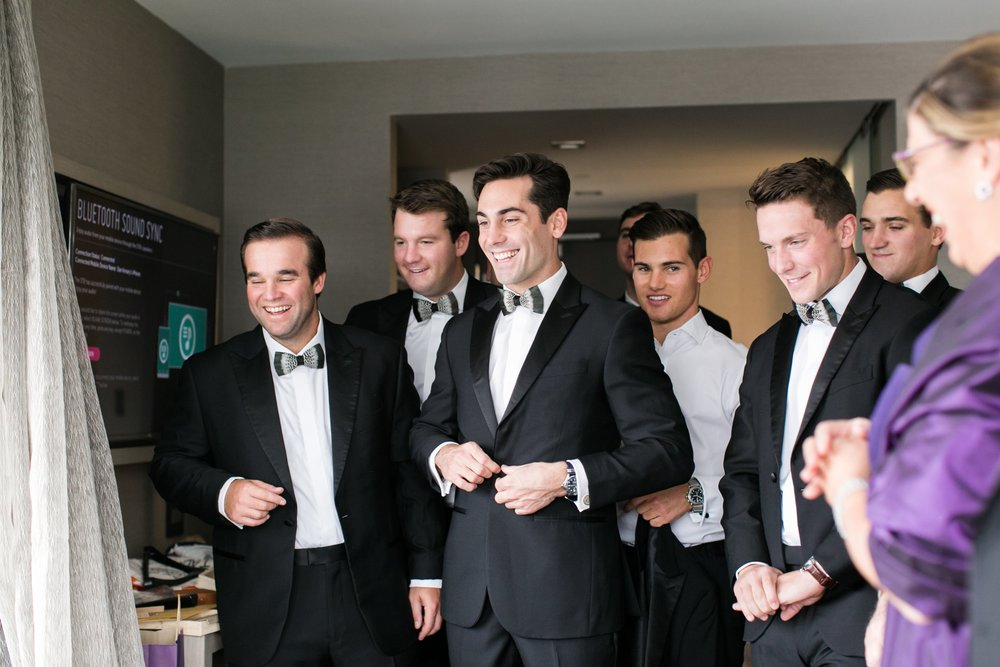 The College of the Holy Cross Wedding Groom and groomsmen getting ready for black tie wedding
