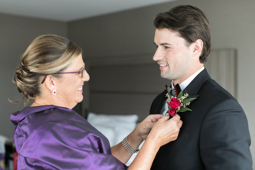 The College of the Holy Cross Wedding Groom and mom getting ready for black tie wedding