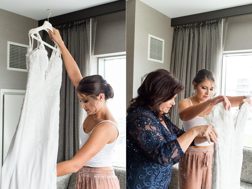 The College of the Holy Cross Wedding bride and mom getting ready Pronovias wedding gown