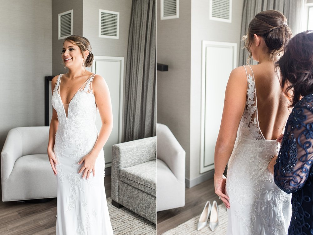 The College of the Holy Cross Wedding bride  getting ready Pronovias wedding gown