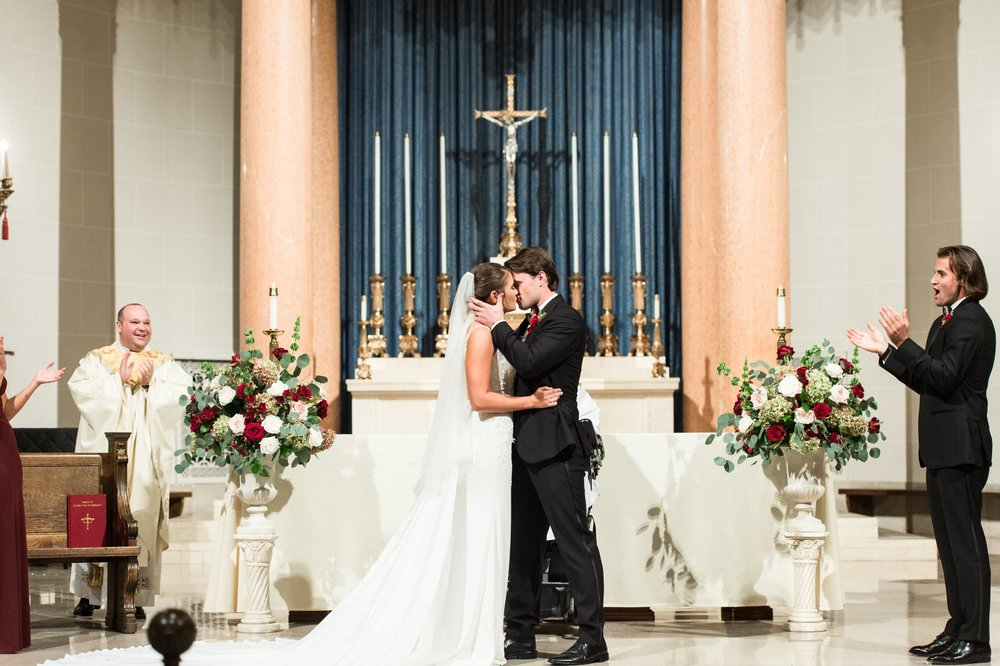 First Kiss During The College of the Holy Cross Wedding Ceremony at Saint Joseph Chapel