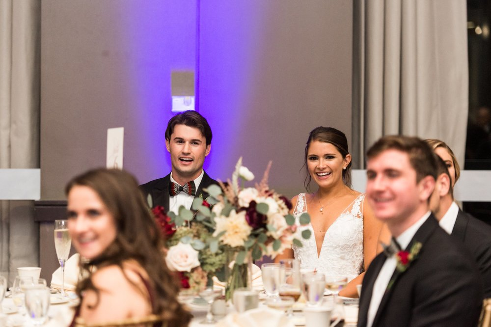 Toasts to bride and groom at Hogan Campus Center Holy Cross Alumni Wedding