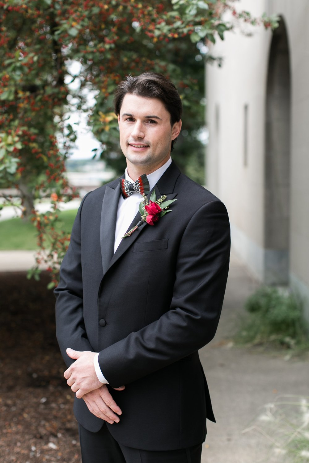 Groom in brackish feather tie and tux for The College of the Holy Cross Wedding