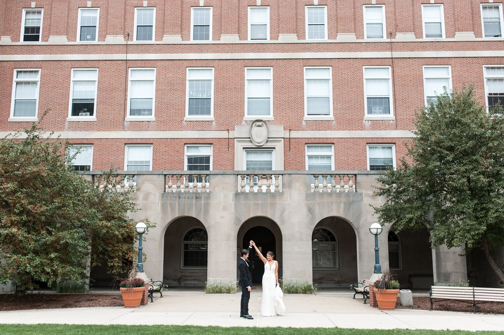 bride and groom outside dorms for first look at their college of the holy cross wedding