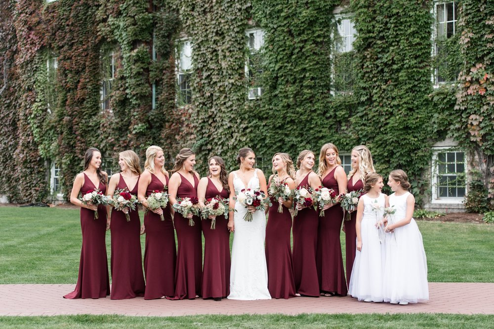 Bride in Pronovias Gown and Bridesmaids in BHLDN dresses for fall wedding at The College of the Holy Cross