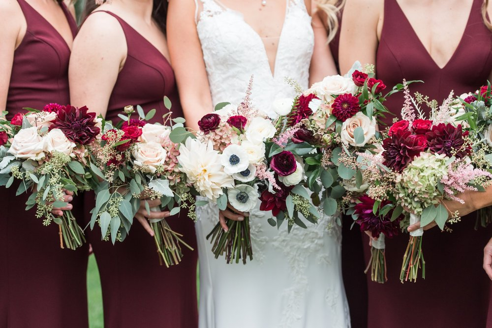 The Flowering Vine fall bouquets in cranberry for The College of the Holy Cross Wedding