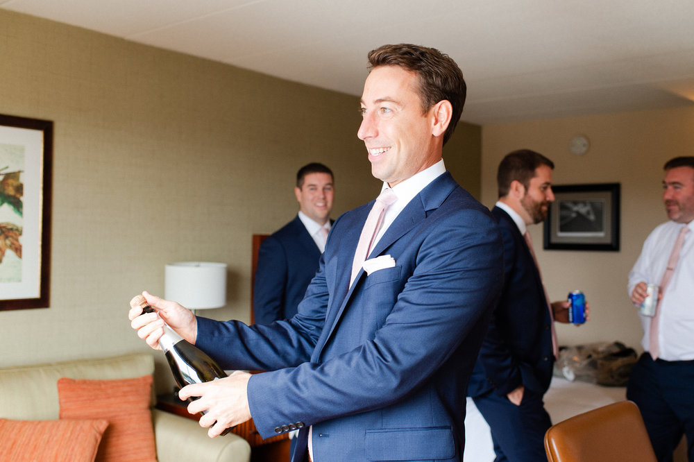 The Commons 1854 Topsfield MA wedding | Massachusetts wedding venue | Massachusetts wedding photography | groom getting ready | groom style | navy suit and pink tie