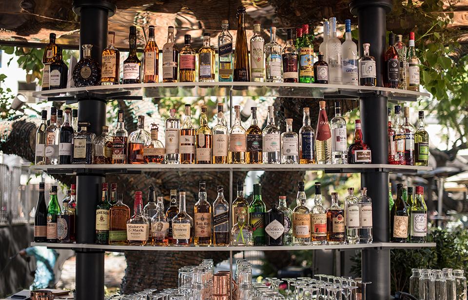 Bar Shelves with Copious Bottles of Liquor