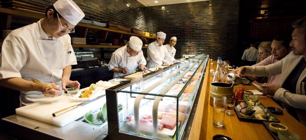 Sushi Chefs At Sushi Bar