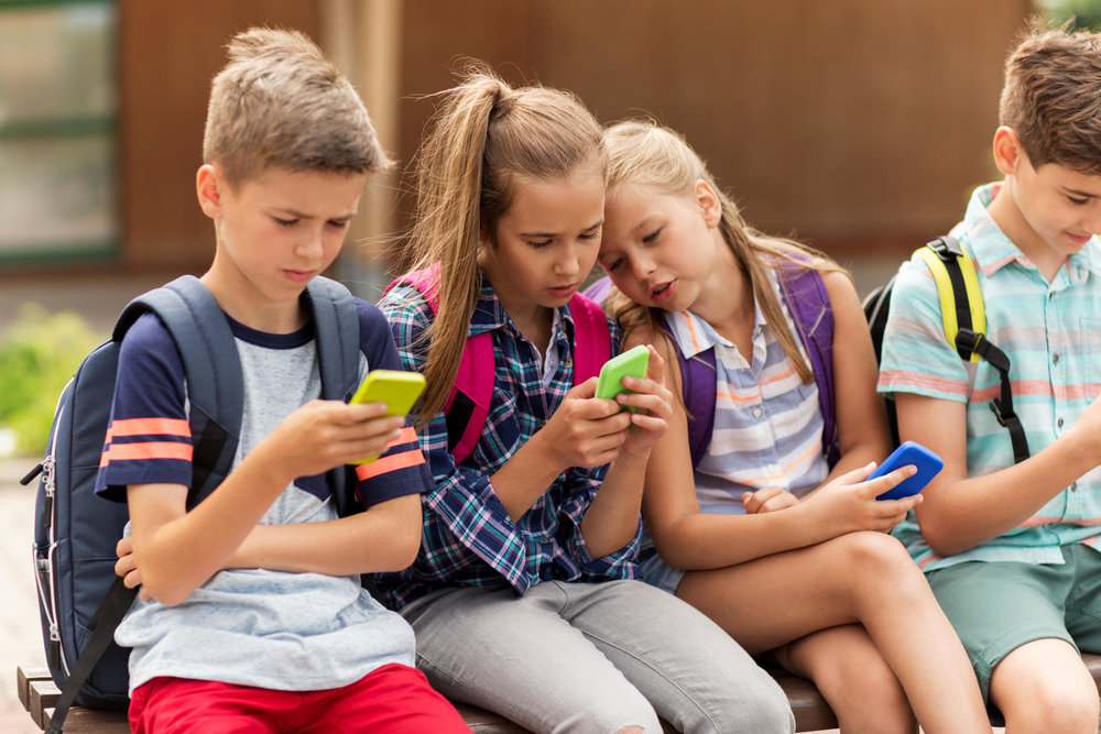 Kids on cellphones. The author is disgusted.