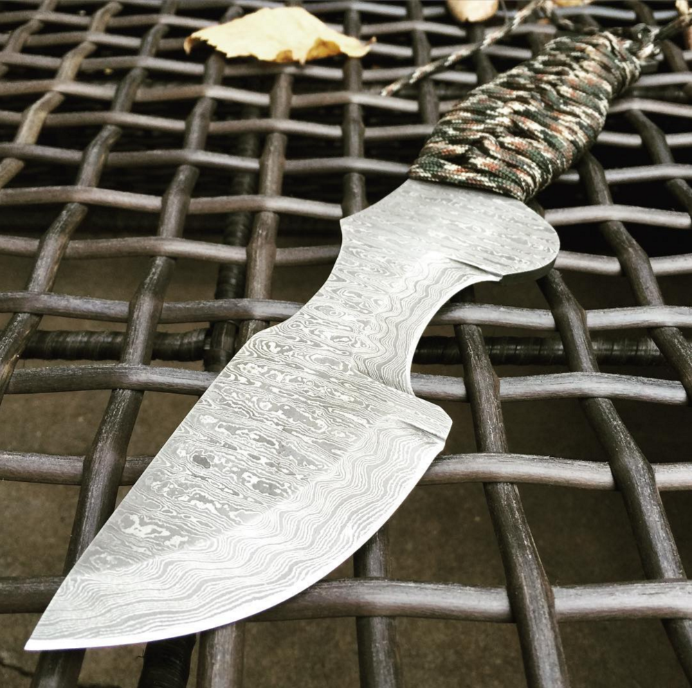 Tracker in Damascus - Strider-weave handle.