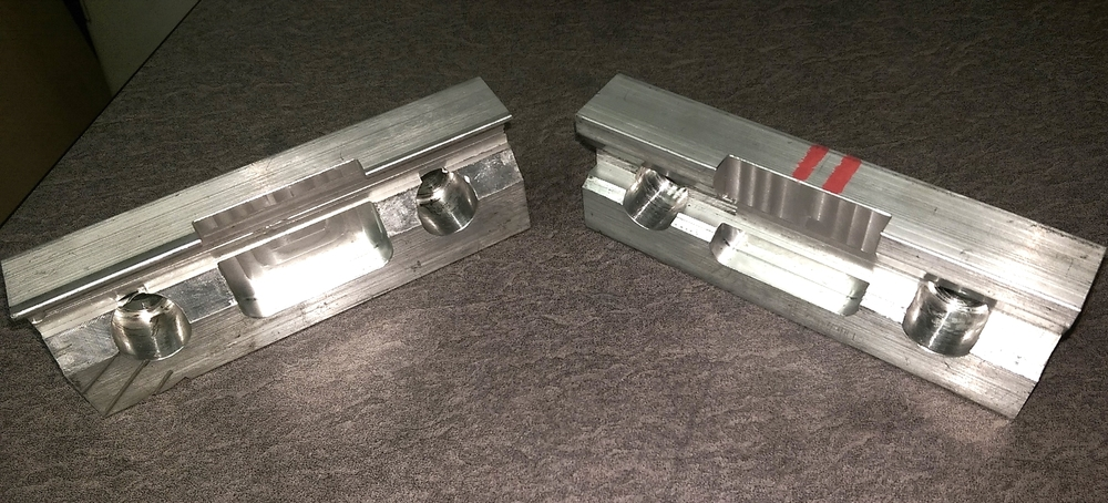 These are the front and back vise jaws removed from the vise; they were machined from solid aluminum.