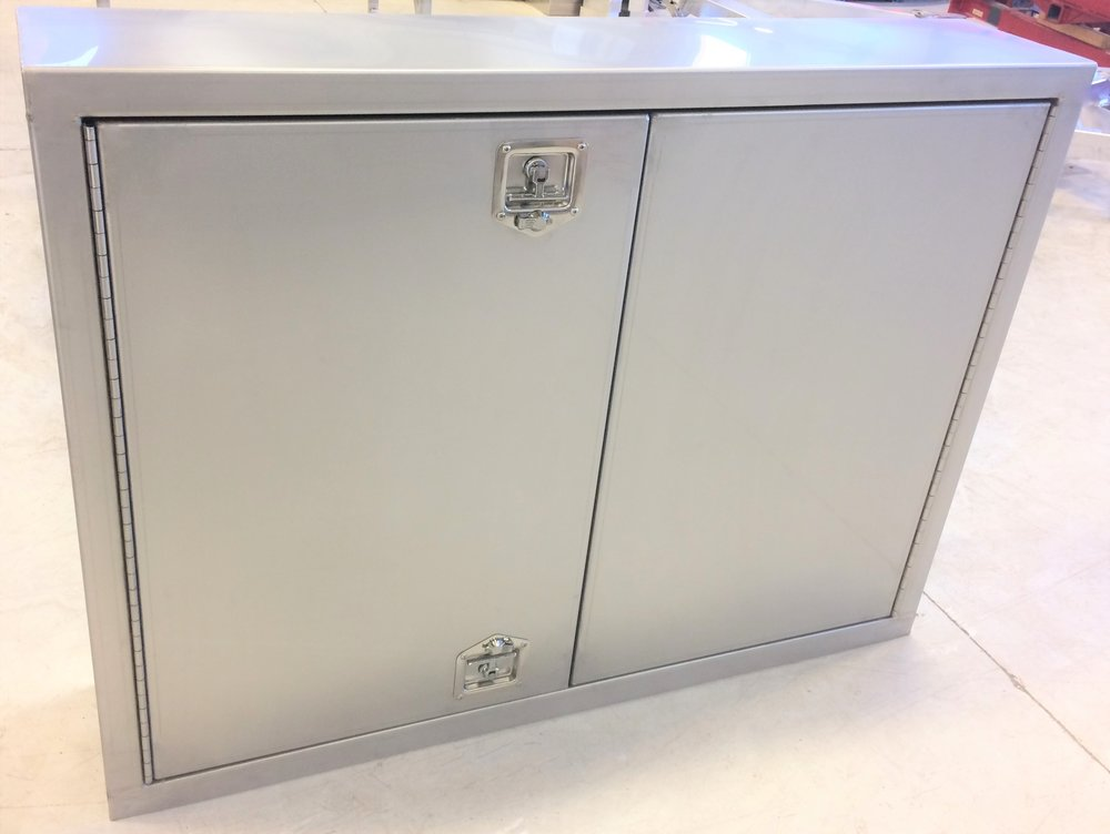 The shell of the cabinet is fabricated entirely of stainless steel: 16 gauge stainless panels with a 2B finish, recessed stainless T-latches, and continuous stainless hinge.