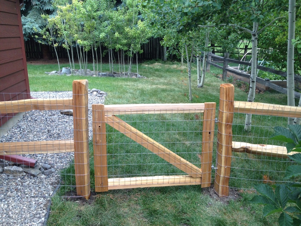 Split cedar fencesgive your yard a rustic look, and wire can be added (as shown here) to keep in pets.